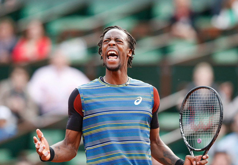 . Gael Monfils of France reacts during his men\'s singles match against Tomas Berdych of Czech Republic at the French Open tennis tournament at the Roland Garros stadium in Paris May 27, 2013. Monfils, whose career has recently been hampered by injuries, returned to the French Open with a bang on Monday to beat Czech fifth seed Berdych in a first-round marathon. REUTERS/Vincent Kessler