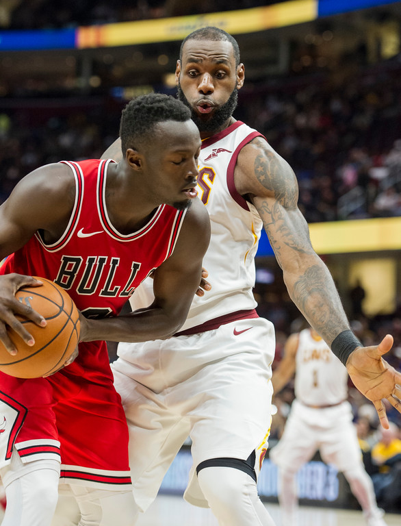 . Cleveland Cavaliers\' LeBron James guards Chicago Bulls\' Jerian Grant during the first half of an NBA preseason basketball game in Cleveland, Tuesday, Oct. 10, 2017. (AP Photo/Phil Long)