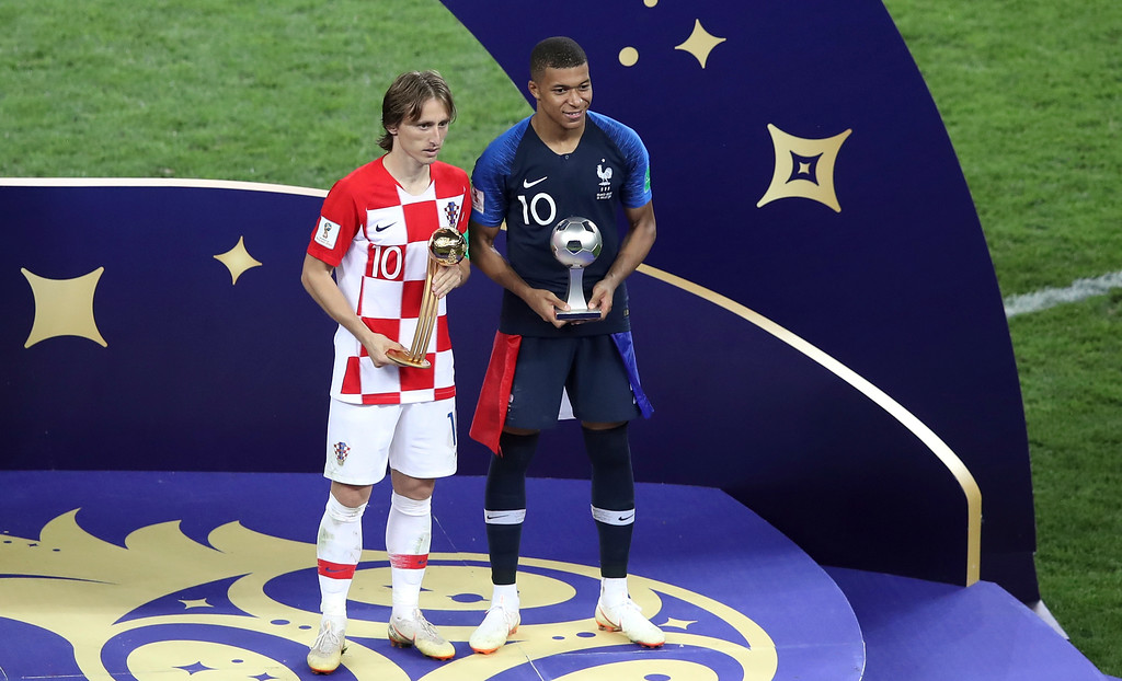 . Croatia\'s Luka Modric and France\'s Kylian Mbappe, right, pose with their individual awards at the end of the final match between France and Croatia at the 2018 soccer World Cup in the Luzhniki Stadium in Moscow, Russia, Sunday, July 15, 2018. (AP Photo/Thanassis Stavrakis)