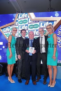 Press Eye - Belfast - Northern Ireland - 27th May 2016 - Photo by Kelvin Boyes / Press Eye.  Sunday Life Spirit of Northern Ireland Awards sponsored by Specsavers at the Culloden Estate & Spa resort in Holywood. Winner of the Overcoming Adversity Award Colin Bell is pictured with Sir Anthony McCoy, Tony McGinn from Specsavers  and Specsavers models Nicola and Laura Crimmons.