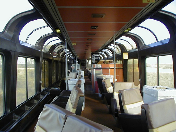 Contemporary AMTRAK lounge car, built by Pullman Standard starting in 1975 through Bombardier's Superliner II lounges in 1994. Based on a 1956 design by the Santa Fe for the El Capitan. This makes an interesting contrast to the swank surroundings of the Cedar Rapids and it's sister cars.