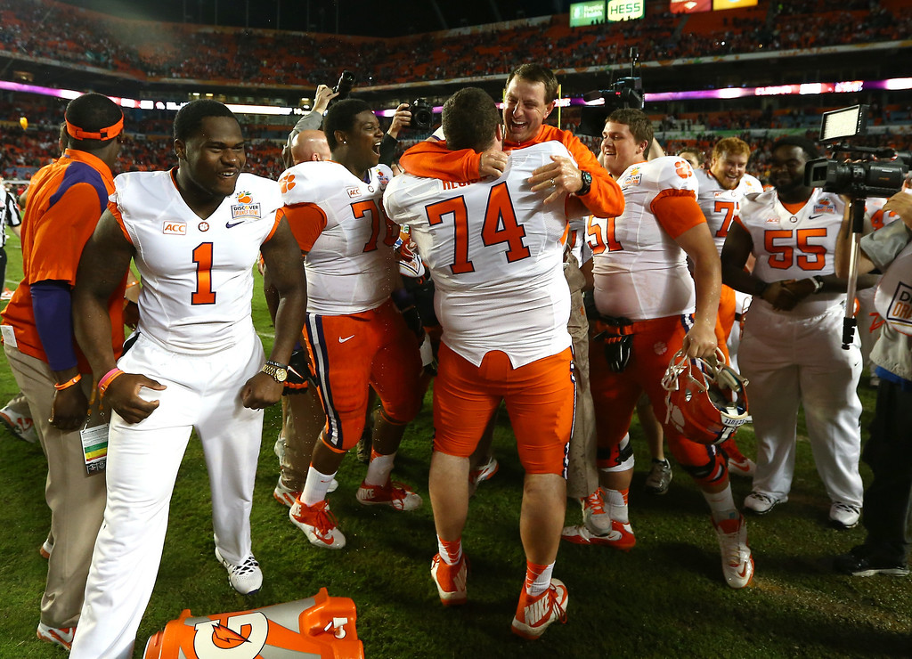 . MIAMI GARDENS, FL - JANUARY 03: Head coach Dabo Swinney of the Clemson Tigers celebrates with his team late in the game against the Ohio State Buckeyes during the Discover Orange Bowl at Sun Life Stadium on January 3, 2014 in Miami Gardens, Florida. Clemson defeated Ohio State 40-35. (Photo by Streeter Lecka/Getty Images)