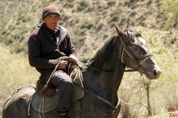 Portrait Kyrgyzstan: man on horse
