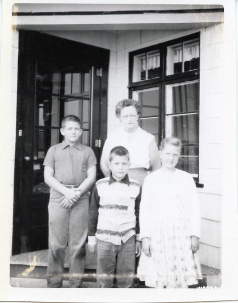 1956-08-06 Nana (Jasmine Mieras), John, Sue & Greg.jpg