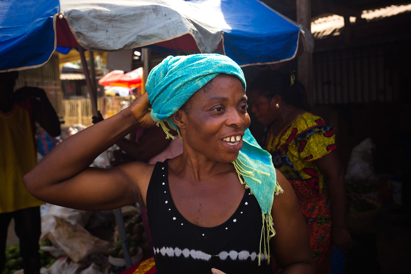 A market seller at the Dome Market shares a laugh with another market seller. There is a strong sense of community among market sellers at any of the markets in Ghana.