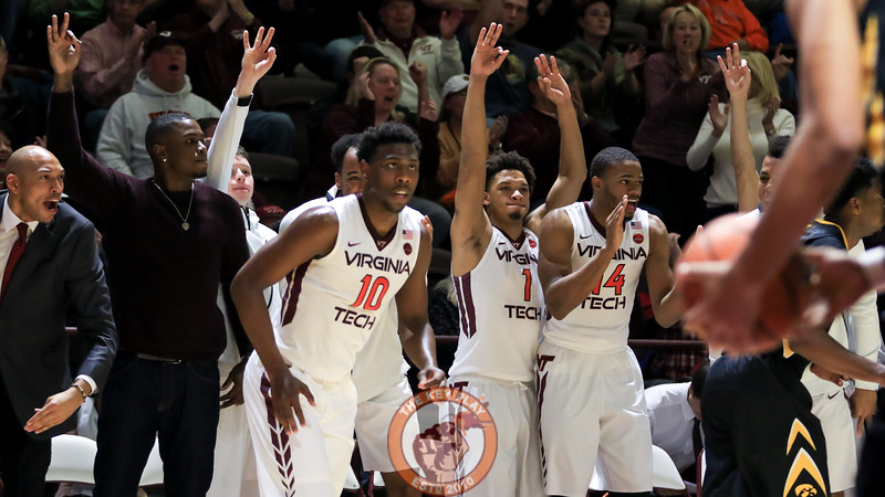 Justin Bibbs watches as a three point shot lands home while the Virginia Tech bench celebrates behind him. (Mark Umansky/TheKeyPlay.com)