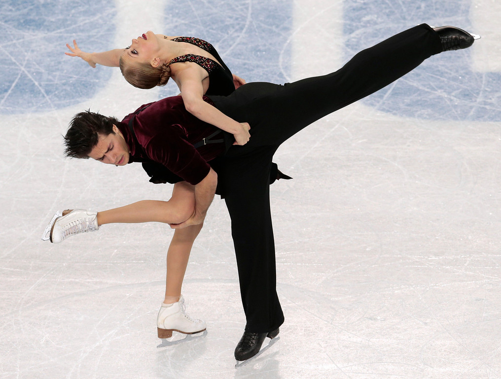 . Kaitlyn Weaver and Andrew Poje of Canada compete in the ice dance free dance figure skating finals at the Iceberg Skating Palace during the 2014 Winter Olympics, Monday, Feb. 17, 2014, in Sochi, Russia. (AP Photo/Ivan Sekretarev)