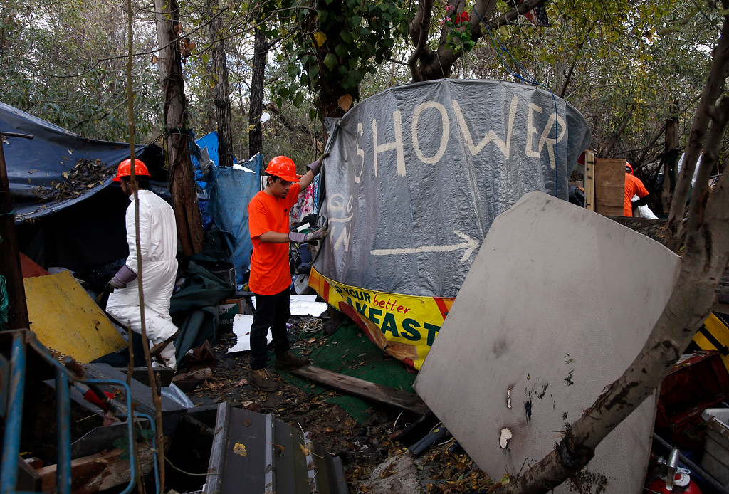 . Demolition crews tear down The Jungle homeless camp along Story Road  in San Jose, Calif., after the city closed it Thursday, Dec. 4, 2014. (Karl Mondon/Bay Area News Group)