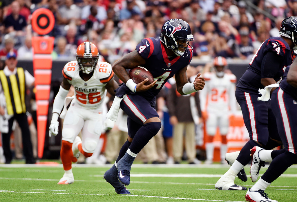 . Cleveland Browns\' Derrick Kindred pursues as Houston Texans quarterback Deshaun Watson (4) carries the ball in the second half of an NFL football game, Sunday, Oct. 15, 2017, in Houston. (AP Photo/Eric Christian Smith)