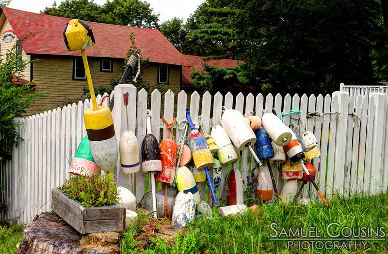 Buoys on a fence on Peaks Island