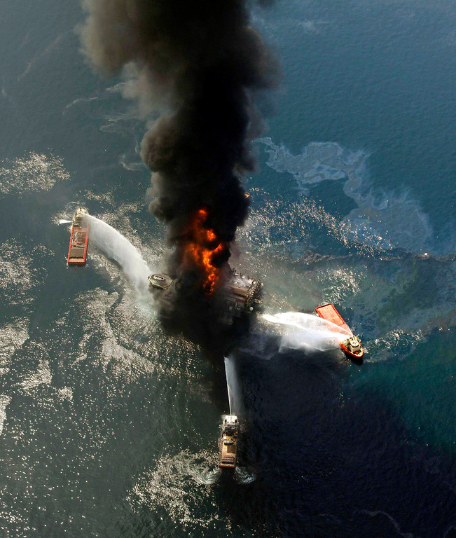 . FILE - This April 21, 2010 file photo shows the Deepwater Horizon oil rig burning after an explosion in the Gulf of Mexico, off the southeast tip of Louisiana.     (AP Photo/Gerald Herbert, File)