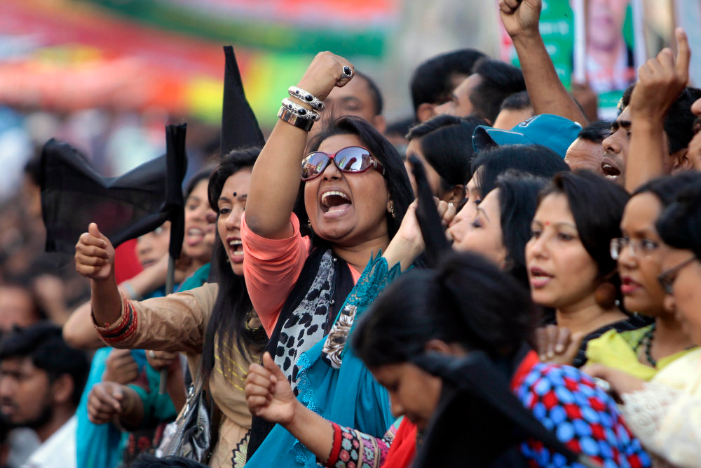 . Opposition Bangladesh Nationalist Party (BNP) activists shout slogans against the government during a protest in Dhaka, Bangladesh, Saturday, March 2, 2013. Demonstrators protesting the death penalty given to Delwar Hossain Sayedee, one of the top leaders of the country\'s largest Islamic party Jamaat-e-Islami, clashed with Bangladeshi security forces for a third straight day on Saturday, killing two people and injuring about a dozen, police said. (AP Photo)
