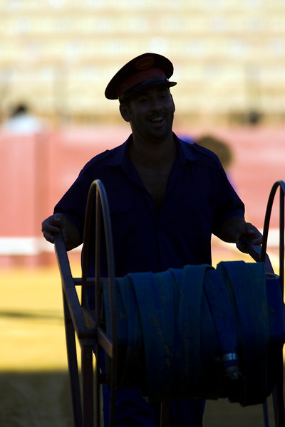 Maestranza bullring employees preparing the arena before a bullfight, Seville, autonomous community of Andalusia, southern Spain