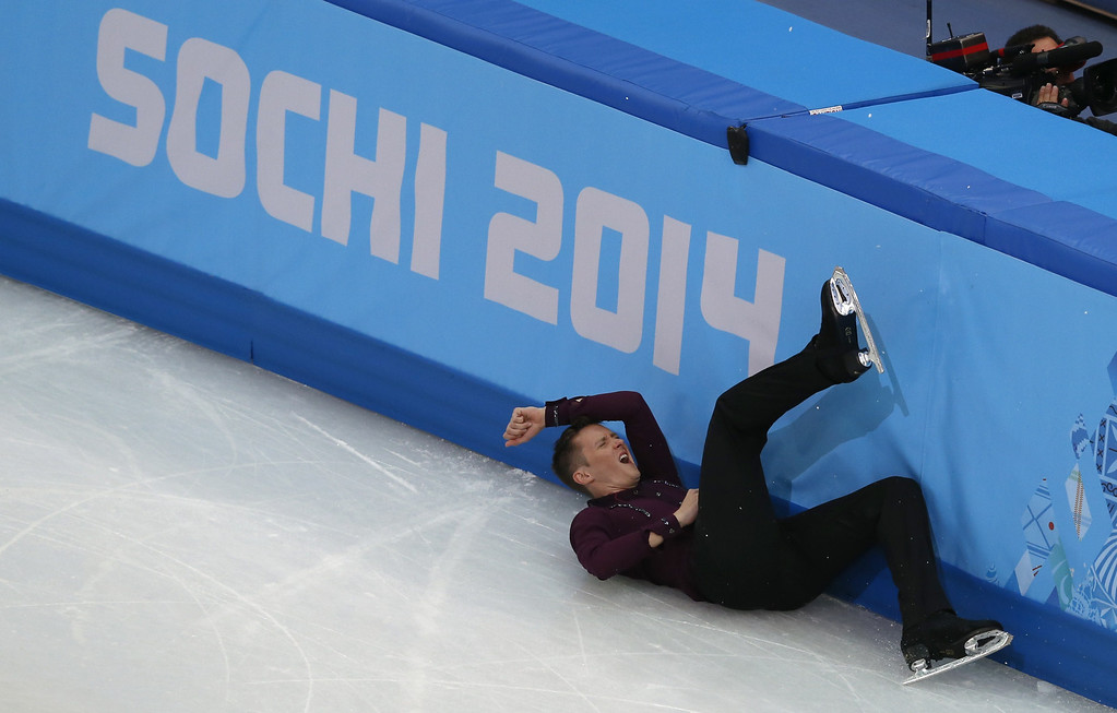 . US Jeremy Abbott falls as he performs during the Men\'s Figure Skating Short Program at the Iceberg Skating Palace during the Sochi Winter Olympics on February 13, 2014. ADRIAN DENNIS/AFP/Getty Images