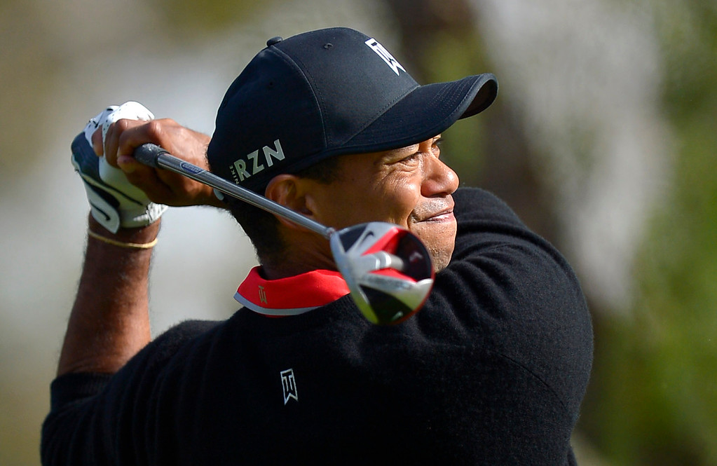 . Tiger Woods hits a tee shot on the fourth hole during the final round of the Northwestern Mutual World Challenge golf tournament at Sherwood Country Club, Sunday December 8, 2013, in Thousand Oaks, Calif.(Andy Holzman/Los Angeles Daily News)