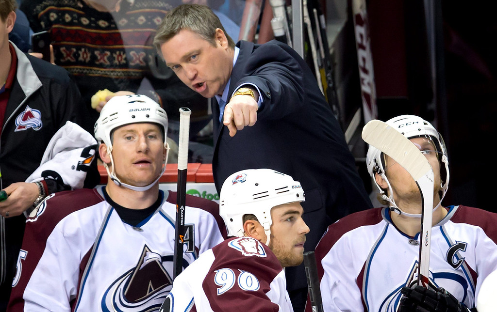 . Colorado Avalanche head coach Patrick Roy, center, speaks to Cody McLeod, left, as Ryan O\'Reilly, bottom, and Gabriel Landeskog, right, of Sweden, look on during second period NHL hockey action against the Vancouver Canucks in Vancouver, British Columbia, on Sunday Dec. 8, 2013. (AP Photo/The Canadian Press, Darryl Dyck)