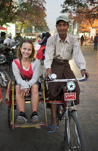 Ana and our friendly trishaw driver through Mandalay.