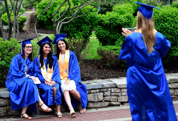 5/30/2019 Mike Orazzi | Staff Tunxis students, Michelle Haines, Hannah Naumec, Olivia Sagan and Amber Humphrey gather at CCSU for Thursday night's graduation ceremony in New Britain.