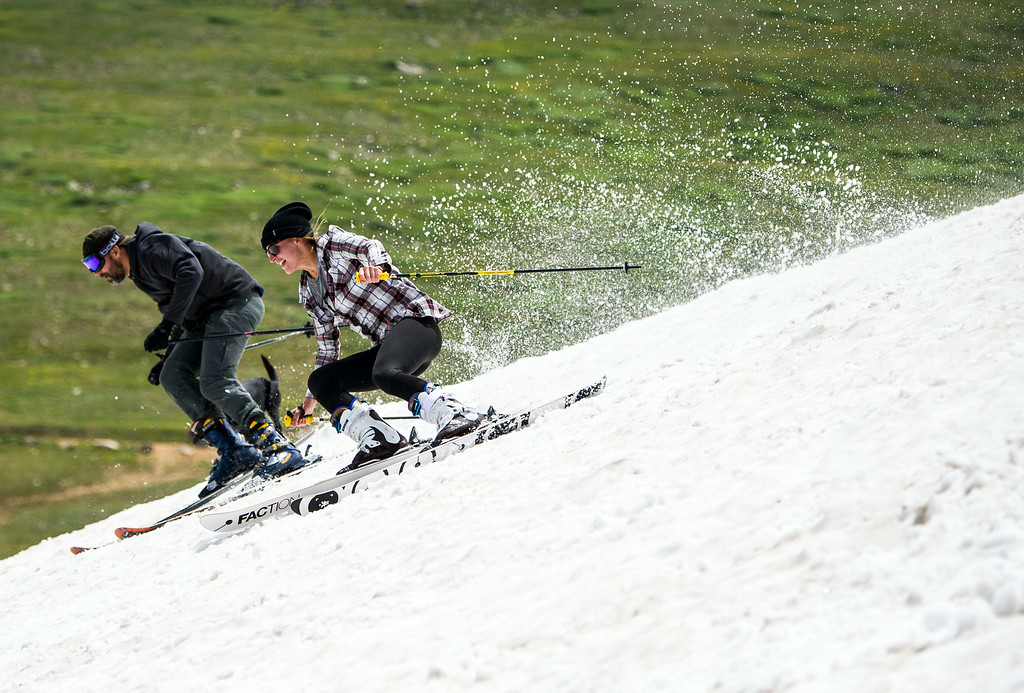 . Erica Thomas, of Winter Park moves to overtake Emur Jensen of Fraser during the 49th running of the Epworth Cup, an unofficial ski race atop Corona Pass on Sunday, July 13, 2014 in Winter Park, CO.  The summer ski race, which was originally founded in 1966 is a memorial to a Winter Park patroller that died on Mt. Epworth.  (Photo by Kent Nishimura/The Denver Post)