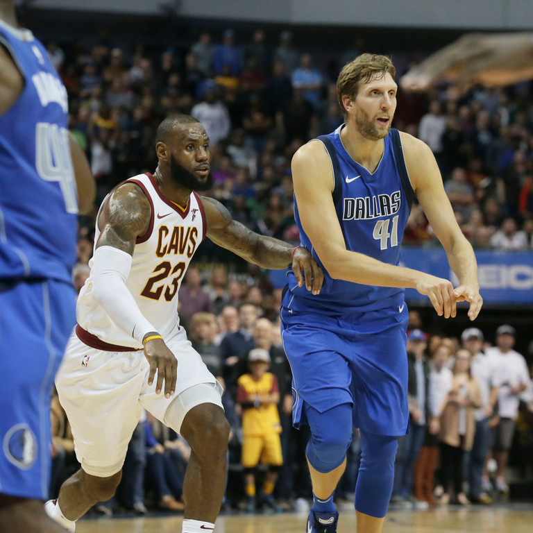 . Dallas Mavericks forward Dirk Nowitzki (41), of Germany, and Cleveland Cavaliers forward LeBron James (23) play during the second half of an NBA basketball game in Dallas, Saturday, Nov. 11, 2017. (AP Photo/LM Otero)