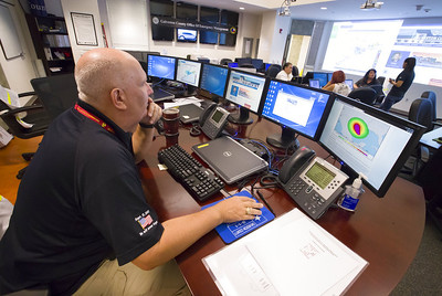 a-map-of-the-texas-coast-is-projected-on-a-screen-as-deb-nowinski-a-disability-integration-coordinator-gives-information-to-a-caller-regarding-the-approach-of-hurricane-harvey-at-the-galvest