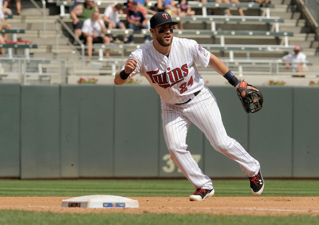 . Minnesota Twins\' Trevor Plouffe during a baseball game against the Detroit Tigers in Minneapolis, Sunday, Aug. 24, 2014. (AP Photo/Tom Olmscheid)