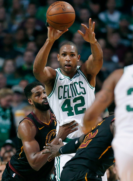 . Boston Celtics forward Al Horford (42) makes a pass in front of Cleveland Cavaliers center Tristan Thompson during the first half in Game 7 of the NBA basketball Eastern Conference finals, Sunday, May 27, 2018, in Boston. (AP Photo/Elise Amendola)