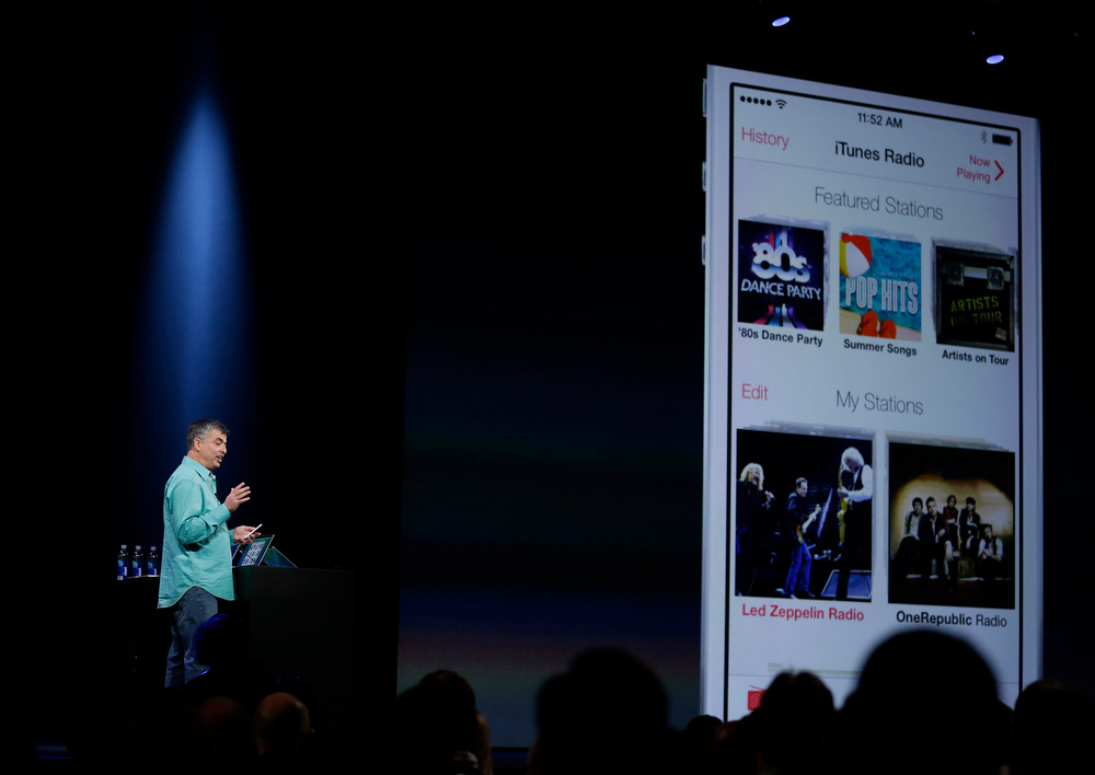 . Eddy Cue the Apple senior vice president of Internet Software and Services demonstrates the new iTunes Radio during the keynote address of the Apple Worldwide Developers Conference Monday, June 10, 2013 in San Francisco. (AP Photo/Eric Risberg)