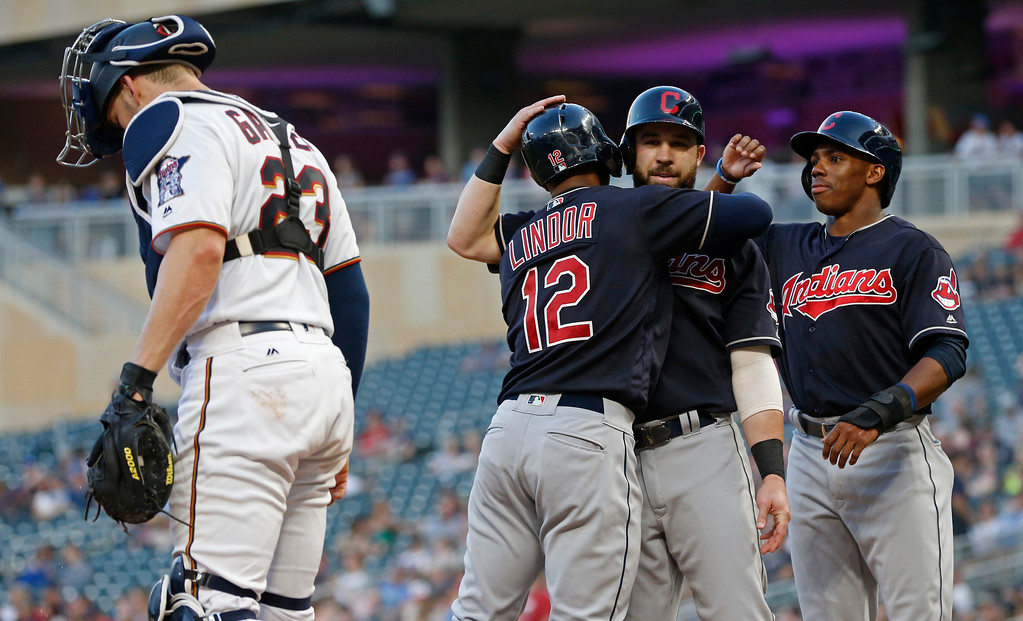 . Cleveland Indians\' Francisco Lindor (12) is congratulated by Jason Kipnis and Greg Allen after Lindor\'s three-run home run off Minnesota Twins pitcher Jake Odorizzi during the fourth inning of a baseball game Thursday, May 31, 2018, in Minneapolis. At left is Twins catcher Mitch Garver. (AP Photo/Jim Mone)