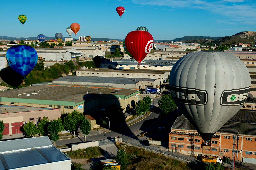 . Hot air balloons fly over Igualada during an early flight as part of the European Balloon Festival on July 10, 2014 in Igualada, Spain. The early morning flight of over 30 balloons was shorter than expected due to windy weather.   (Photo by David Ramos/Getty Images)