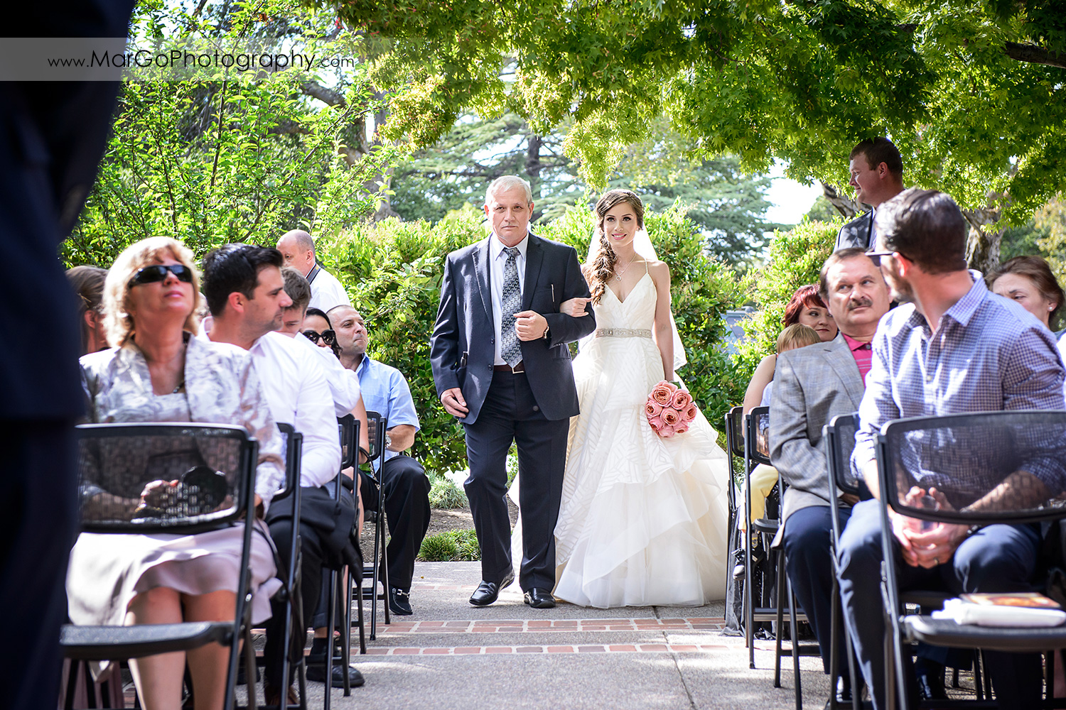 bride walking down the aisle with her father during wedding ceremony at Saratoga Foothill Club