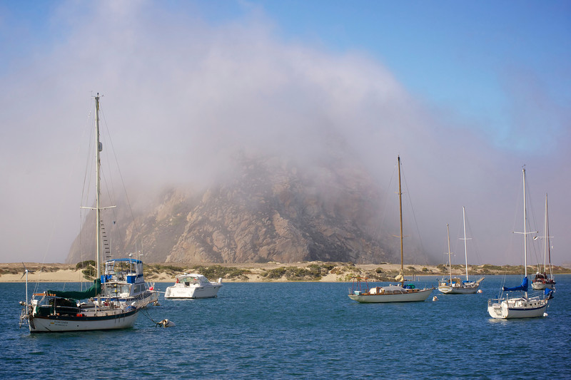 Morro Rock covered in fog. Perhaps as seen by Portuguese explorers in 1542. Morro Rock is the remains of a chain of extinct volcanoes.  An ancient landmark, Morro Rock was named by Juan Rodriguez Cabrillo during his voyage along the California coast. ref: 29c2a3e6-149d-489a-bfc6-dc874eaa7751