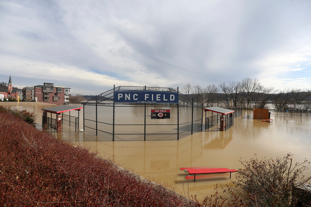 . PNC Field is seen under water at the Le Blond Community Center in the East End, Sunday, Feb. 25, 2018. Heavy rains overnight have sent the swollen Ohio River to its highest point in 20 years with the river expected to remain above flood stage through the end of the week, a National Weather Service meteorologist said Sunday. (Kareem Elgazzar/The Cincinnati Enquirer via AP)