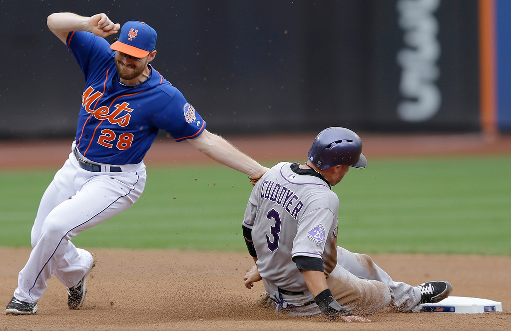 . New York Mets second baseman Daniel Murphy (28) catches Colorado Rockies\'s Michael Cuddyer (3) stealing second base  in the fourth inning of a baseball game in New York, Thursday, Aug. 8, 2013. (AP Photo/Kathy Willens)