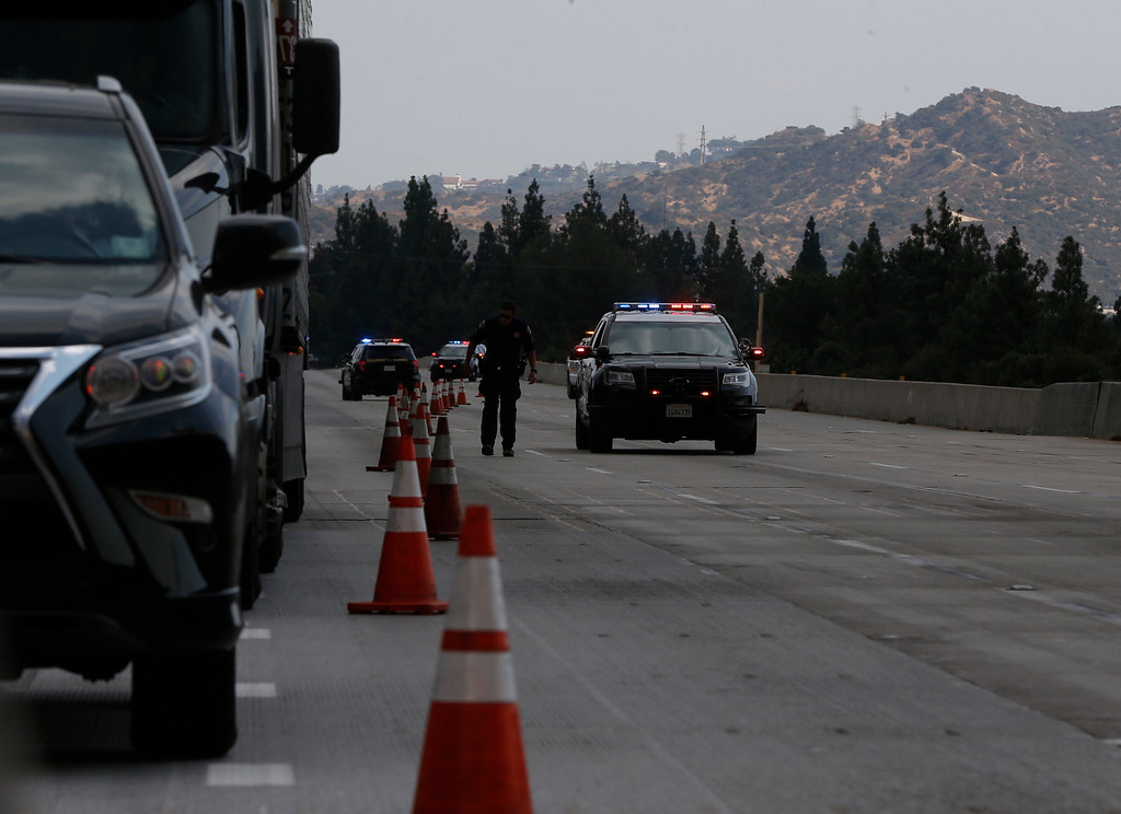 . California highway Patrol close the 210 East bound Freeway as a brush fire burns in the Verdugo Mountains in the Sun Valley neighborhood of Los Angeles. (AP Photo/Damian Dovarganes)