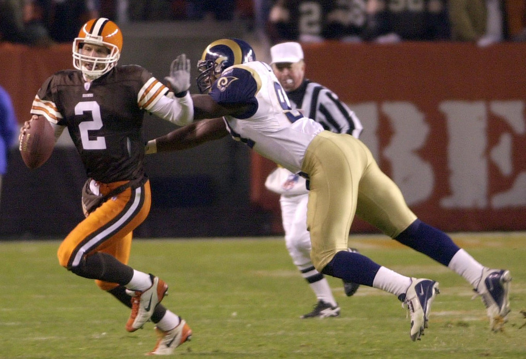 . News-Herald file Tim Couch is chased down by Leonard Little