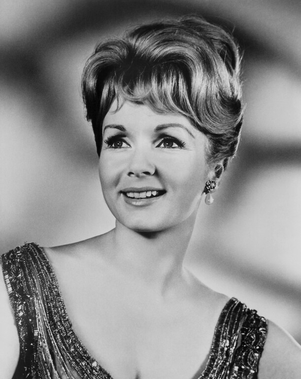 ". In this photo provided by Metro Goldwyn Mayer, Debbie Reynolds, who was starring in ""The Unsinkable Molly Brown,\"" is shown, 1964 - Reynolds, star of the 1952 classic \""Singin\' in the Rain\"" died Wednesday, Dec. 28, 2016, according to her son Todd Fisher. She was 84. (AP Photo/MGM)"
