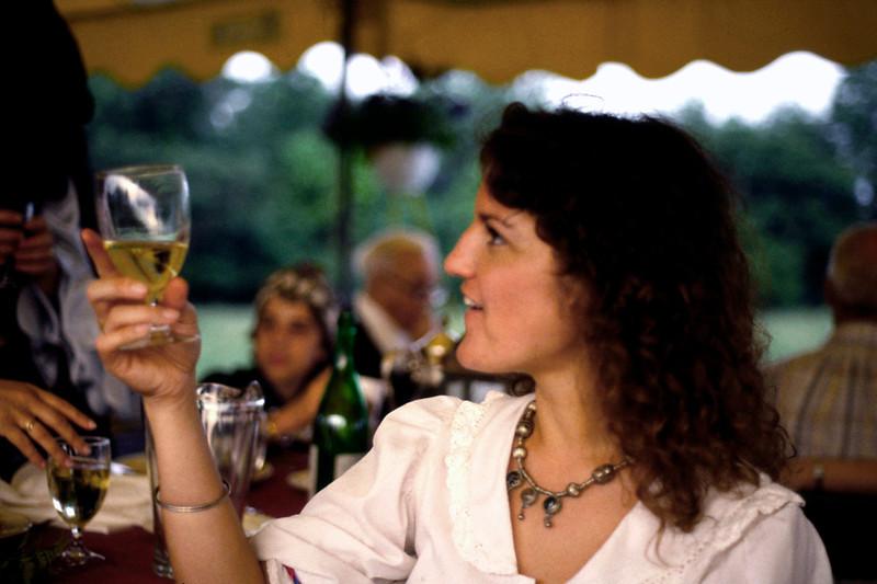 Lisa raises a glass at Jim and Marla's wedding, June 1984.