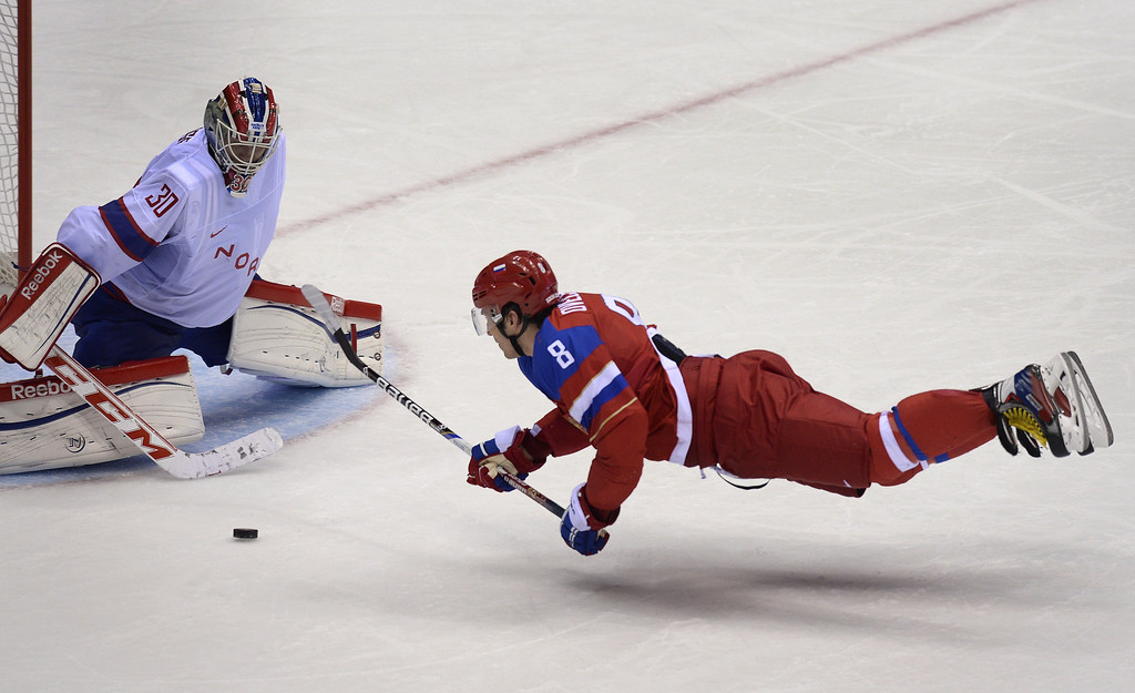 . Russia\'s Alexander Ovechkin (R) attacks on Norway\'s goalkeeper Lars Haugen during the Men\'s Ice Hockey play-offs qualification match Russia vs Norway at the Bolshoy Ice Dome during the Sochi Winter Olympics on February 18, 2014. ALEXANDER NEMENOV/AFP/Getty Images