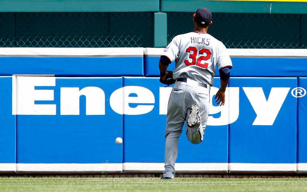 . Center fielder Aaron Hicks, of the Minnesota Twins, chases a fly ball hit by Avisail Garcia of the Detroit Tigers for a bases loaded triple in the sixth inning. The Tigers defeated the Twins 6-1. (Photo by Duane Burleson/Getty Images)