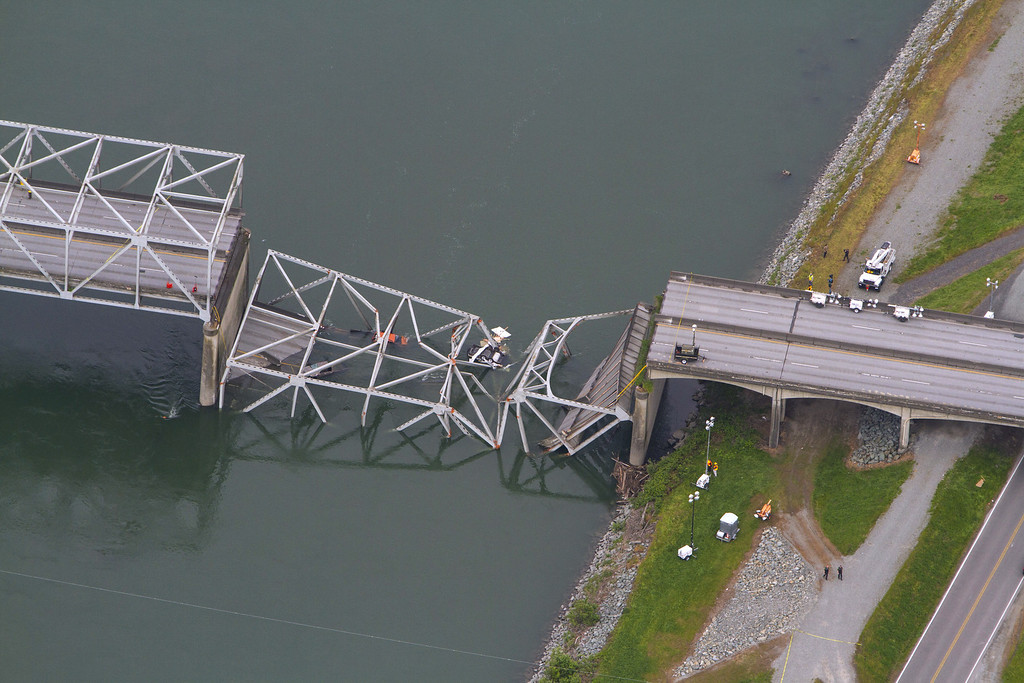. A collapsed section of the Interstate 5 bridge over the Skagit River is seen in an aerial view Friday, May 24, 2013. Part of the bridge collapsed Thursday evening, sending cars and people into the water when a an oversized truck hit the span, the Washington State Patrol chief said. Three people were rescued from the water. Washington Gov. Jay Inslee on Friday declared a state of emergency in three counties around the bridge, saying that the bridge collapse has caused extensive disruption, impacting the citizens and economy in Skagit, Snohomish and Whatcom Counties.  (AP Photo/The Seattle Times, Mike Siegel)