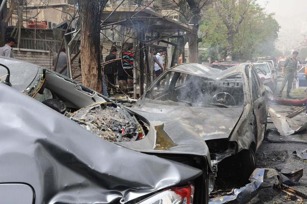 Description of . A view shows wreckage of cars after a suicide car bomb exploded in the main business district of Damascus April 8, 2013, in this handout photograph distributed by Syria\'s national news agency SANA .The death toll from a suicide car bomb which exploded in central Damascus on Monday rose to 15, with 47 wounded, Syrian state television said. REUTERS/SANA/Handout