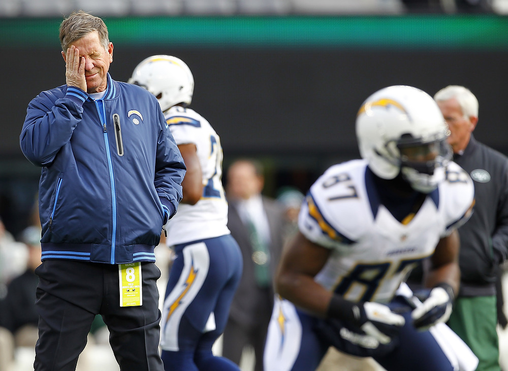 Description of . Head coach Norv Turner of the San Diego Chargers watches his team during warm ups before the start of their game against the New York Jets at MetLife Stadium on December 23, 2012 in East Rutherford, New Jersey. (Photo by Rich Schultz /Getty Images)