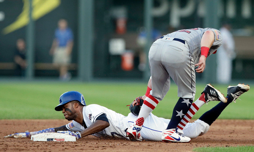 . Kansas City Royals\' Rosell Herrera, left, is tagged out by Cleveland Indians second baseman Jason Kipnis during the third inning of a baseball game at Kauffman Stadium in Kansas City, Mo., Wednesday, July 4, 2018. (AP Photo/Orlin Wagner)