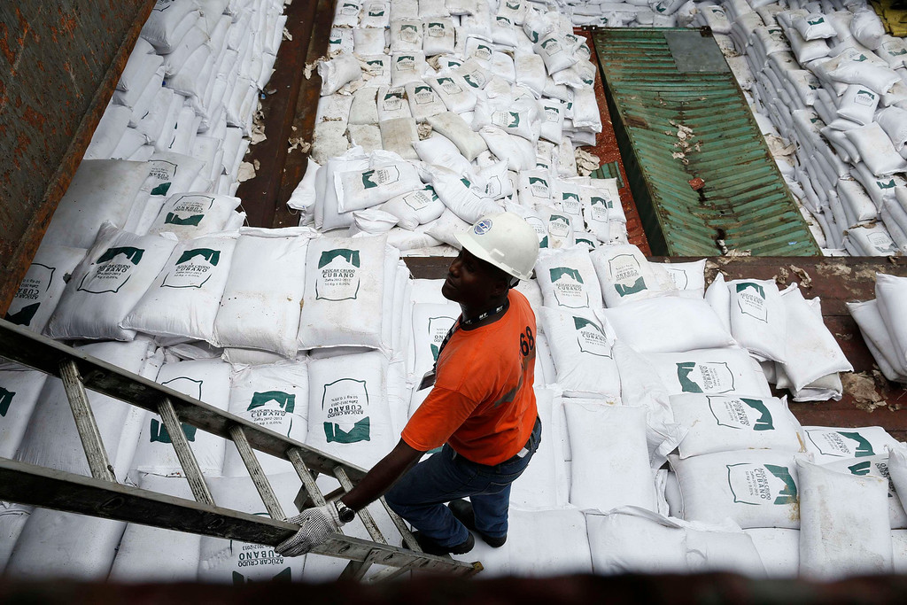 """. A worker stands nest to gags labeled \""""Cuban Raw Sugar\"""" are seen inside a North Korean flagged ship \""""Chong Chon Gang\"""" docked at the Manzanillo Container Terminal in Colon City July 16, 2013.  REUTERS/Carlos Jasso"""