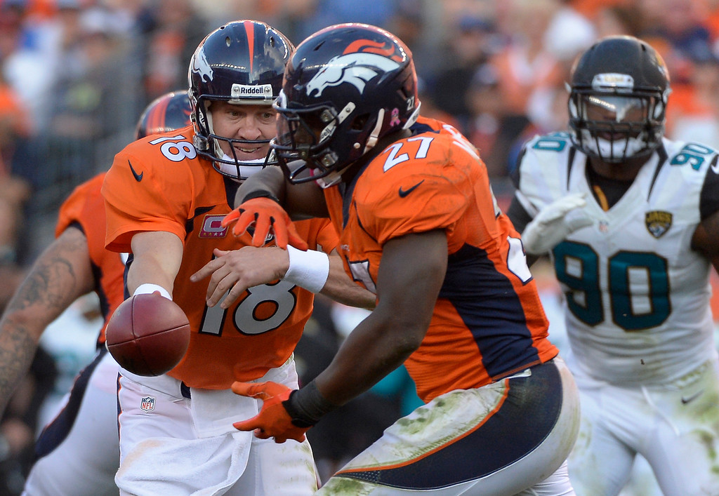 . Denver Broncos quarterback Peyton Manning #18 handing off to running back Knowshon Moreno #27 in the 4th quarter vs the Jacksonville Jaguars at Sports Authority Field at Mile High. August 13, 2013 Denver, October. (Photo By Joe Amon/The Denver Post)