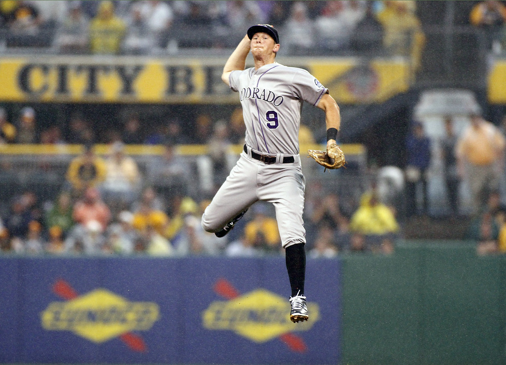 . PITTSBURGH, PA - JULY 19: Vinny Castilla #9 of the Colorado Rockies makes a throw from second base in the third inning against the Pittsburgh Pirates during the game at PNC Park July 19, 2014 in Pittsburgh, Pennsylvania. (Photo by Justin K. Aller/Getty Images)