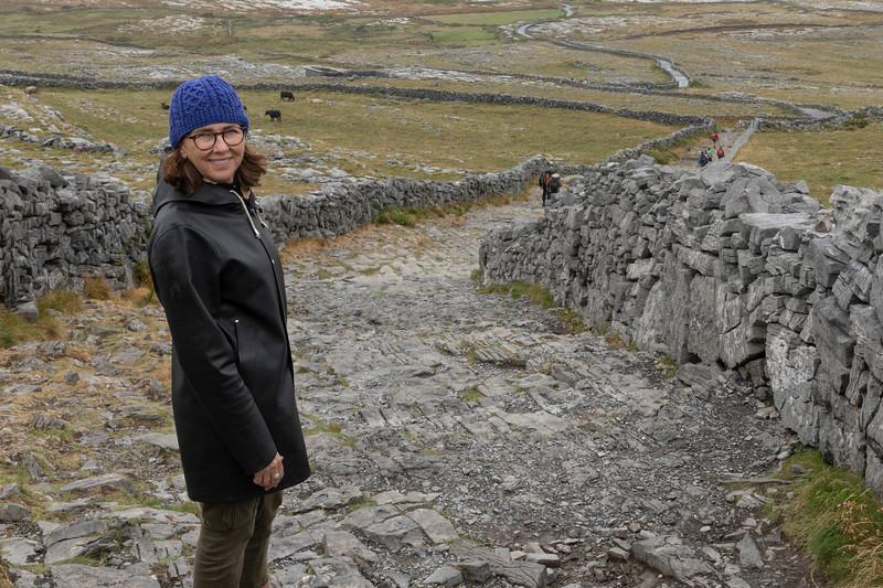 Woman exploring ruins on the hills at Dun Aengus, Inishmore, Inishmore, Ireland