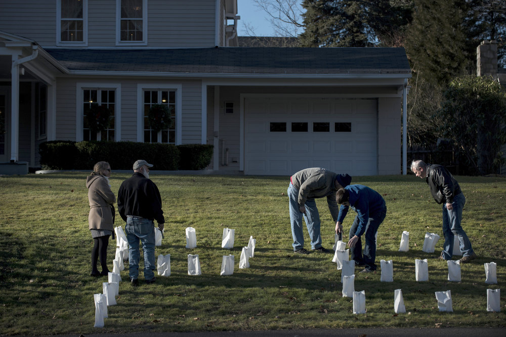 . People set up luminary candles before visiting hours for Dawn Hochsprung at the Woodbury Funeral Home on December 19, 2012 in Woodbury, Connecticut. Dawn Lafferty Hochsprung, the principle of Sandy Hook Elementary School, was one of 6 adults in addition to 20 children who were killed in last Friday\'s shooting at Sandy Hook.  AFP PHOTO/Brendan  SMIALOWSKI/AFP/Getty Images