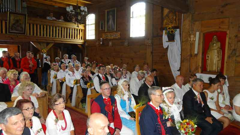 A large group of Polish Texans dressed in traditional attire attended the ceremony